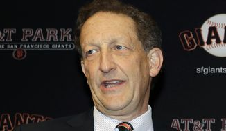 """FILE - In this Jan. 19, 2018, file photo, San Francisco Giants President and CEO Larry Baer is shown during a press conference in San Francisco. Major League Baseball has suspended San Francisco Giants President and CEO Larry Baer without pay until July 1 in response to a video released earlier this month showing him in a physical altercation with his wife. Commissioner Rob Manfred said Tuesday, March 26, 2019, that Baer's conduct on the video was """"unacceptable"""" and warranted discipline. (AP Photo/Marcio Jose Sanchez, File)"""