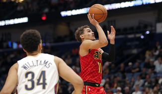Atlanta Hawks guard Trae Young (11) shoots in the first half of an NBA basketball game against the New Orleans Pelicans in New Orleans, Tuesday, March 26, 2019. (AP Photo/Gerald Herbert)