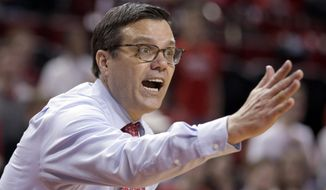 FILE- In this March 10, 2019, file photo, Nebraska coach Tim Miles yells instructions during an NCAA college basketball game against Iowa, in Lincoln, Neb. Nebraska has fired seventh-year coach Tim Miles after the Cornhuskers finished 13th in the Big Ten and failed to make the NCAA Tournament for a fifth straight year.Athletic director Bill Moos announced the firing Tuesday, March 26, 2019, two days after the Huskers finished a 19-17 season with an 88-72 loss to TCU in the second round of the NIT. (AP Photo/Nati Harnik, file)