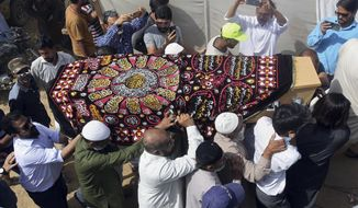 Mourners carry the casket of Syed Areeb Ahmed, a victim of the Christchurch mosque shootings, during his funeral in Karachi, Pakistan, Monday, March 25, 2019. Ahmed was among nine Pakistanis who were killed on March 15 when a white supremacist shot people inside two mosques in Christchurch, New Zealand. (AP Photo/Fareed Khan)