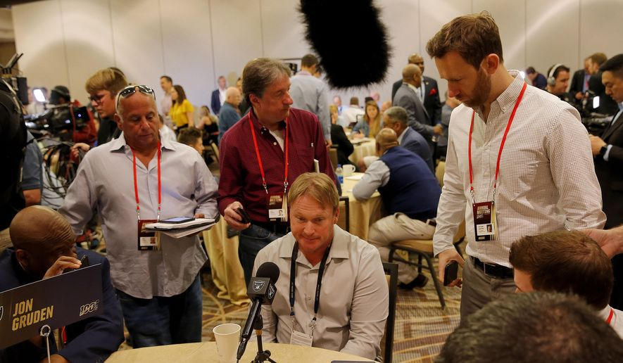 Oakland Raiders head coach Jon Gruden speaks to the media during the NFC/AFC coaches breakfast during the annual NFL football owners meetings, Tuesday, March 26, 2019, in Phoenix. (AP Photo/Matt York)