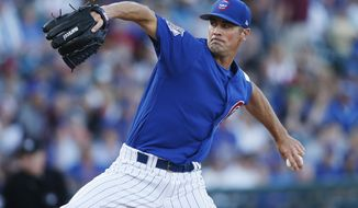 Chicago Cubs pitcher Cole Hamels throws during the first inning of a spring training baseball game against the Boston Red Sox on Monday, March 25, 2019, in Mesa, Ariz. (AP Photo/Sue Ogrocki)
