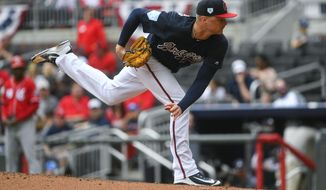Atlanta Braves' Sean Newcomb pitches during the third inning of an exhibition baseball game against the Cincinnati Reds on Tuesday, March 26, 2019, in Atlanta. (AP Photo/John Amis)