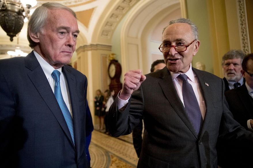 Senate Minority Leader Sen. Chuck Schumer of N.Y., right, accompanied by Sen. Ed Markey, D-Mass., left, speaks to members of the media following a Senate policy luncheon on Capitol Hill in Washington, Tuesday, March 26, 2019. (AP Photo/Andrew Harnik) ** FILE **