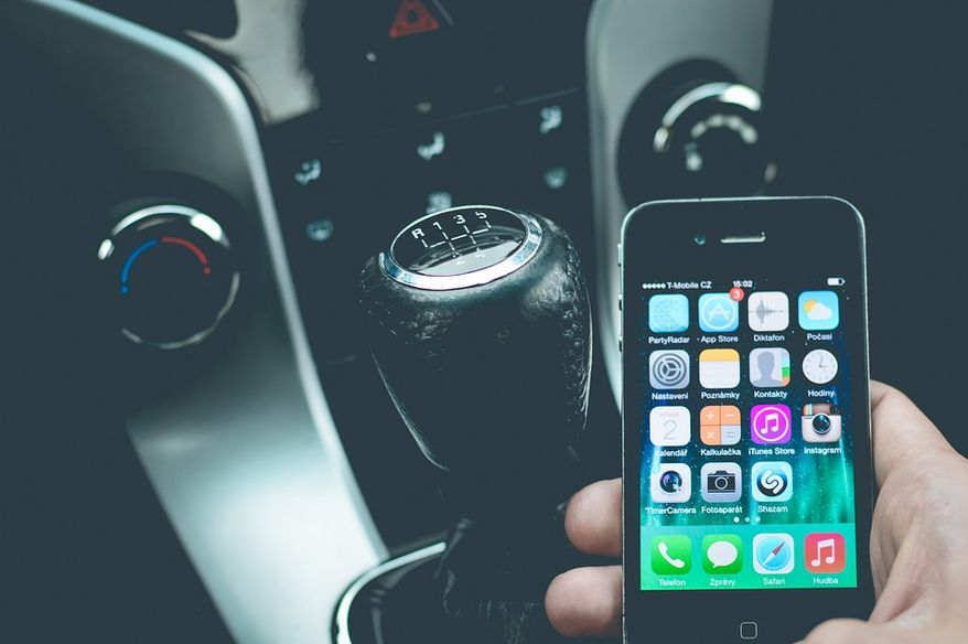 FILE: Talking while driving, smartphone, cellphone in car via Pixabay