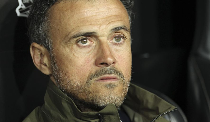 Spain's Luis Enrique sits prior to the start of the Euro 2020 group F qualifying soccer match between Spain and Norway at the Mestalla stadium in Valencia, Spain, Saturday, March 23, 2019. (AP Photo/Alberto Saiz)