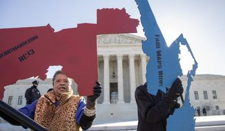 Activists at the Supreme Court opposed to partisan gerrymandering hold up representations of congressional districts from North Carolina, left, and Maryland, right, as justices hear arguments about the practice of political parties manipulating the boundary of a congressional district to unfairly benefit one party over another, in Washington, Tuesday, March 26, 2019. Democrats and Republicans eagerly await the outcome of cases from Maryland and North Carolina because a new round of redistricting will follow the 2020 census, and the decision could help shape the makeup of Congress and state legislatures over the next decade. (AP Photo/Carolyn Kaster) **FILE**