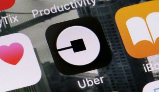 This June 12, 2018, file photo shows the Uber app on a phone in New York. Ride-hailing service Uber announced on Tuesday, March 26, 2019, it has acquired its Mideast competitor Careem for $3.1 billion, making it the largest-ever technology purchase in the region. (AP Photo/Richard Drew, File)