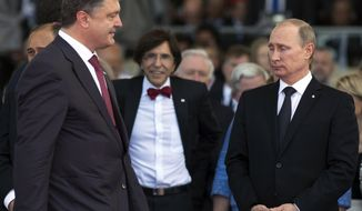 FILE - In this Friday, June 6, 2014 file photo, Ukraine's President-elect Petro Poroshenko, left, walks past Russian President Vladimir Putin, right, during the commemoration of the 70th anniversary of the D-Day in Ouistreham, western France. Five years into Ukraine's conflict with Russia, Moscow seems to have Ukraine pinned against the ropes. Ukraine's ambition of joining the EU and NATO is indefinitely stalled, it has no realistic way to reclaim control of Russian-annexed Crimea, or to end the war with Russia-backed separatists in the east. It's no wonder a comedian is leading in the polls for the presidential election on Sunday, March 31, 2019. (AP Photo/Alexander Zemlianichenko, pool)