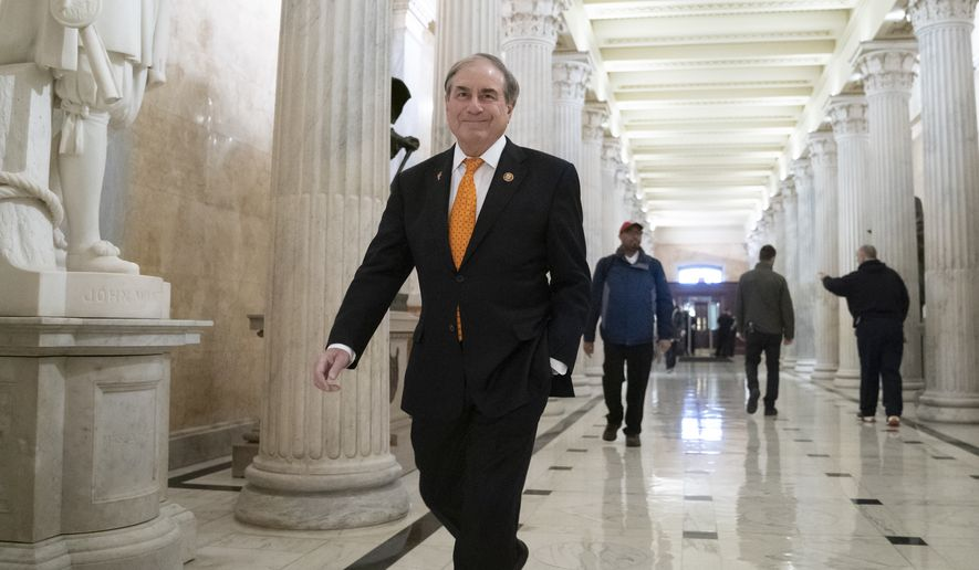 House Budget Committee Chair John Yarmuth, D-Ky., walks through the Hall of Columns at the Capitol as House Democratic chairs gather for a meeting with Majority Leader Steny Hoyer, D-Md., in Washington, Wednesday, March 27, 2019. (AP Photo/J. Scott Applewhite)