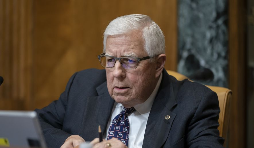 Sen. Mike Enzi, R-Wyo., chairman of the Senate Budget Committee, prepares for the markup of the fiscal year 2020 budget resolution, on Capitol Hill in Washington, Wednesday, March 27, 2019. (AP Photo/J. Scott Applewhite)