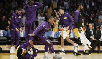 The Los Angeles Lakers bench reacts after Lance Stephenson pulled an ankle breaker on Washington Wizards' Jeff Green during the first half of an NBA basketball game, Tuesday, March 26, 2019, in Los Angeles. (AP Photo/Jae C. Hong)
