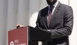 Jason Barnes, Outreach Fellow for the Alabama Voting Rights Project, speaks at a press conference on the importance of the restoration of voting rights to the disenfranchised in Alabama on Wednesday March 27, 2019 on the state capitol steps in Montgomery, Ala. (Mickey Welsh/Montgomery Advertiser via AP)