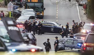 Looking north up Sand Point Way Northeast towards Northeast 123rd Street near the scene of a shooting in Seattle, Wednesday, March 27, 2019. (Steve Ringman/The Seattle Times via AP)