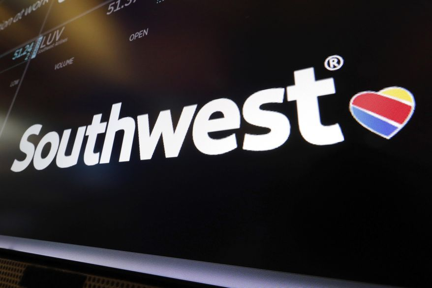 In this Monday, March 18, 2019, file photo, the logo for Southwest Airlines appears above a trading post on the floor of the New York Stock Exchange. The Federal Aviation Administration says a Southwest Airlines Boeing 737 Max jet made a safe emergency landing Tuesday, March 26, 2019, in Orlando, Fla., after experiencing an apparent engine problem. (AP Photo/Richard Drew, File)