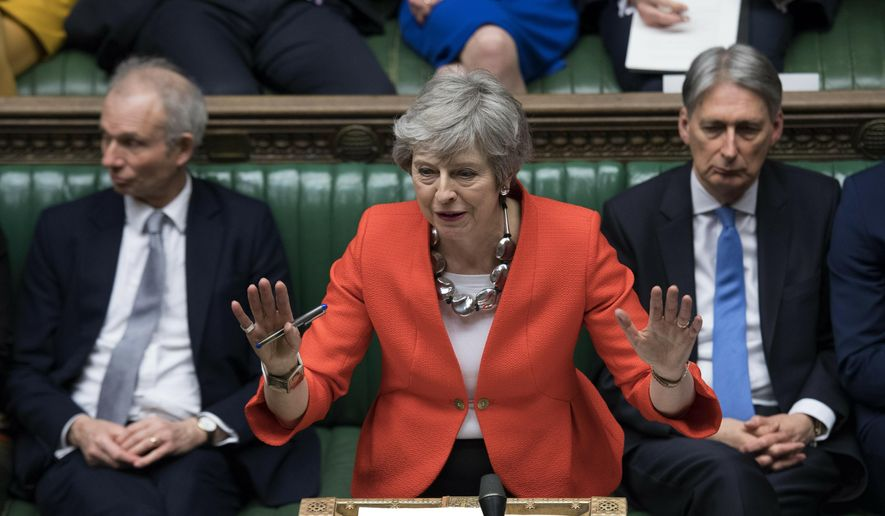 FILE - In this Tuesday March 12, 2019 file photo Britain's Prime Minister Theresa May speaks to lawmakers in parliament, London. According to a UK lawmaker Britain's Prime Minister Theresa May has told the Conservative Party that she will quit once Brexit is delivered but hasn't set a date yet. (Jessica Taylor/UK Parliament via AP, File)
