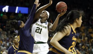 California center CJ West (30) defends as Baylor center Kalani Brown (21) goes up to shoot in the second half of a second-round game in the NCAA women's college basketball tournament in Waco, Texas, Monday, March 25, 2019. (AP Photo/Tony Gutierrez)