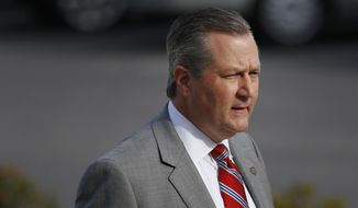 FILE - In this Monday, May 16, 2016, file photo, Rep. Mike Hubbard of Auburn, Ala., walks into the Lee County Justice Center during jury selection for the indicted Alabama speaker of the House in Opelika, Ala. Attorneys for former Alabama House Speaker Hubbard have asked the state Supreme Court to toss out his 2016 conviction on ethics charges, arguing prosecutors stretched the intent of the law when they brought charges against him. (AP Photo/Brynn Anderson, File)