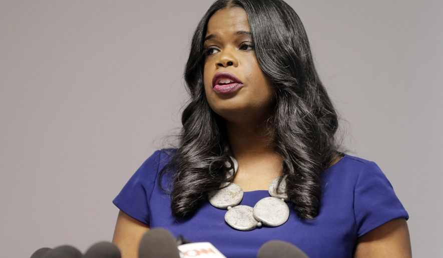 """FILE - In this Feb. 22, 2019 file photo, Cook County State's Attorney Kim Foxx speaks at a news conference in Chicago. Foxx on Wednesday, March 27, 2019, defended the decision by her staff to drop charges that """"Empire"""" actor Jussie Smollett staged a racist, anti-gay attack in January. Foxx recused herself before Smollett was charged last month because she had discussed the case with a Smollett family member. (AP Photo/Kiichiro Sato, File)"""
