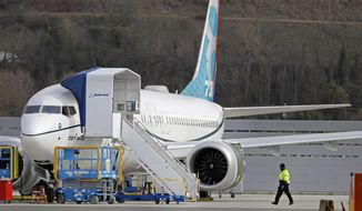This Thursday, March 14, 2019, file photo shows a Boeing 737 Max 8 airplane parked at Boeing Field in Seattle. America's standing as the model for aviation-safety regulation will be on trial as congressional hearings begin Wednesday, March 27, 2019, into the Federal Aviation Administration's oversight of Boeing before and after two deadly crashes of its best-selling airliner. (AP Photo/Ted S. Warren, File)