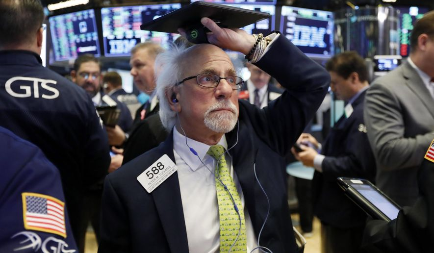 FILE- In this March 5, 2019, file photo trader Peter Tuchman works on the floor of the New York Stock Exchange. The U.S. stock market opens at 9:30 a.m. EDT on Wednesday, March 27. (AP Photo/Richard Drew, File)