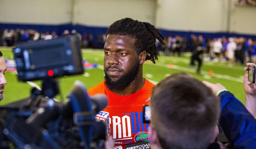 Defensive lineman Jachai Polite answers questions from the media during University of Florida's football Pro Day in Gainesville, Fla., Wednesday, March 27, 2019.  (Lauren Bacho/The Gainesville Sun via AP)