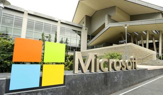 This July 3, 2014 file photo shows Microsoft Corp. signage outside the Microsoft Visitor Center in Redmond, Wash. Hackers linked to the Iranian government have carried out hundreds of recent cyberattacks against American journalists, government officials, and even a 2020 U.S. presidential candidate, Microsoft said in an Oct. 4, 2019 statement. (AP Photo Ted S. Warren, File) **FILE**
