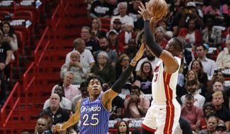 Miami Heat guard Dwyane Wade (3) shoots over Orlando Magic forward Wesley Iwundu (25) in the first quarter during an NBA basketball game Tuesday, March 26, 2019, in Miami.(AP Photo/Joe Skipper)