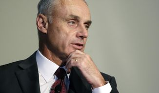 FILE - In this Wednesday, March 6, 2019, file photo, Major League Baseball Commissioner Rob Manfred addresses an audience at a gathering of the Boston College Chief Executives Club in Boston. Good but unexceptional veterans must realize teams find them less valuable in the age of analytics, Manfred maintained ahead of season openers. Players have expressed anger following the second straight slow free-agent market. There have been record deals for top stars and plummeting prices for many journeymen. (AP Photo/Steven Senne, File)