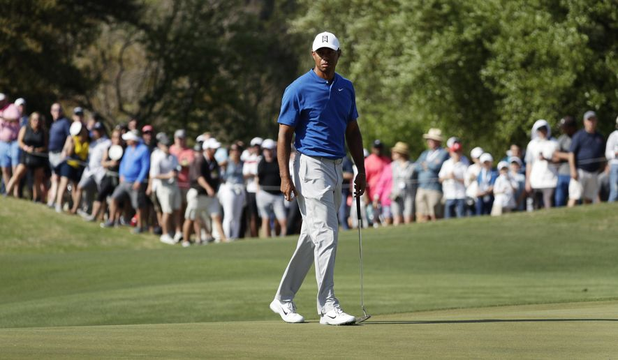 Tiger Woods prepares to putt on the 16th hole during round-robin play at the Dell Match Play Championship golf tournament Wednesday, March 27, 2019, in Austin, Texas. (AP Photo/Eric Gay)