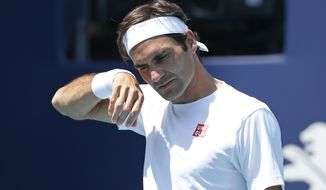 Roger Federer, of Switzerland, warms up for his match against Daniil Medvedev, of Russia, at the Miami Open tennis tournament, Wednesday, March 27, 2019, in Miami Gardens, Fla. (AP Photo/Joel Auerbach)