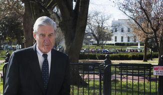 In this March 24, 2019, photo, Special Counsel Robert Mueller walks past the White House after attending St. John's Episcopal Church in Washington for morning services. (Associated Press) **FILE**