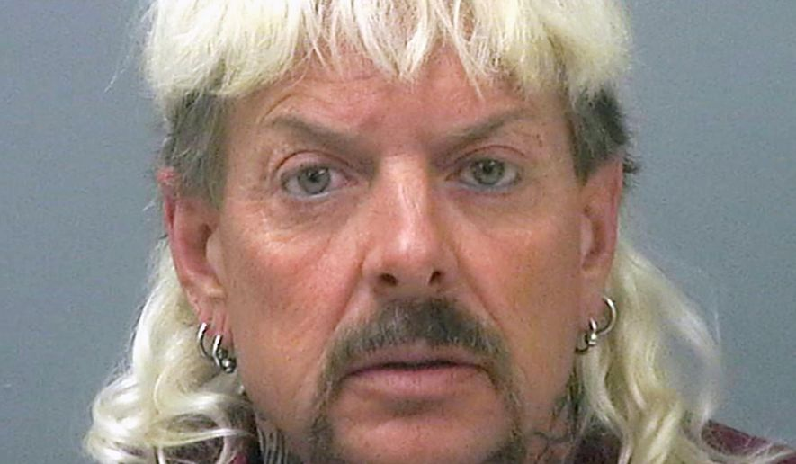 """FILE - This file photo provided by the Santa Rose County Jail in Milton, Fla., shows Joseph Maldonado-Passage. Prosecutors say Maldonado-Passage, also known as """"Joe Exotic, tried to arrange the killing of Carole Baskin, the founder of Big Cat Rescue. Lurors were shown a Facebook video Tuesday, March 26, 2019,  that depicts Maldonado-Passage shooting a blow-up """"Carole"""" doll in the head. Other videos show him pretending to dig a grave for Baskin and threatening to mail her rattlesnakes. (Santa Rosa County Jail via AP, File)"""