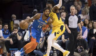 Oklahoma City Thunder forward Paul George (13) fights for position while defended by Indiana Pacers guard Wesley Matthews (23) during the first half of an NBA basketball game Wednesday, March 27, 2019, in Oklahoma City. (AP Photo/Rob Ferguson)