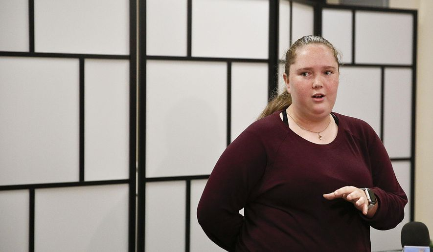 Annabel Claprood, 18, a former Marjory Stoneman Douglas High School student, speaks to the media about the opening of Eagles Haven, a new wellness center created for the MSD community, Wednesday, March 27, 2019, in Coral Springs, Fla. (AP Photo/Brynn Anderson)