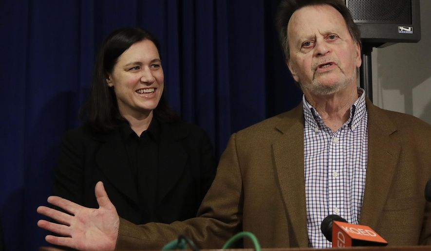 Edwin Hardeman, right, speaks next to attorney Aimee Wagstaff at a news conference in San Francisco, Wednesday, March 27, 2019. A U.S. jury has awarded $80 million in damages to Hardeman in a high-stakes trial over his claim that Roundup weed killer caused his cancer. (AP Photo/Jeff Chiu)