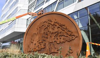 Swedbank's headquarters in Sundbyberg, Stockholm, Wednesday March 27, 2019. The headquarters of one of Sweden's largest banks are being raided by authorities as part of an investigation into whether Swedbank was connected to a massive money laundering scandal in the Baltic countries. (Anders Wiklund/TT via AP)