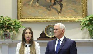 Vice President Mike Pence listens to Fabiana Rosales, left, wife of Venezuelan opposition leader Juan Guaido, as she speaks in the Roosevelt Room of the White House in Washington, Tuesday, March 26, 2019. (AP Photo/Manuel Balce Ceneta)