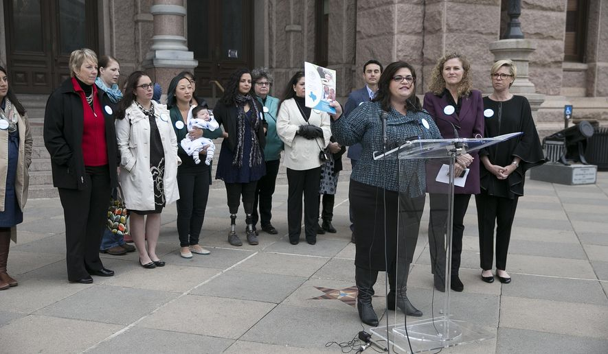 FILE - In this Dec. 7, 2016, file photo, Anna Dragsbaek, president and CEO of The Immunization Partnership, holds up a copy of the nonprofit's report on the status of vaccinations in Texas during a news conference at the Capitol in Austin, Texas. Nearly 50 people in the Texas Capitol received booster shots after a whooping cough scare on the House floor, bringing immunization battles close to home in a chamber where politically active anti-vaccination groups have moved to claim territory. (Deborah Cannon/Austin American-Statesman via AP, File)