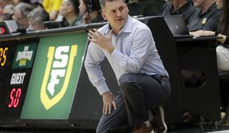 FILE - In this  Jan. 12, 2019, file photo, San Francisco head coach Kyle Smith reacts during the second half of an NCAA college basketball game against Gonzaga in San Francisco. Washington State has hired Kyle Smith as its new men's basketball coach following the disappointing tenure of Ernie Kent, a person with knowledge of the hiring said Wednesday, March 27, 2019. (AP Photo/Jeff Chiu, File)