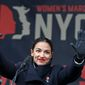 In this Jan. 19, 2019, file photo, U.S. Rep. Alexandria Ocasio-Cortez, D-New York, waves to the crowd after speaking at Women's Unity Rally organized by Women's March NYC at Foley Square in Lower Manhattan in New York. (AP Photo/Kathy Willens, File)