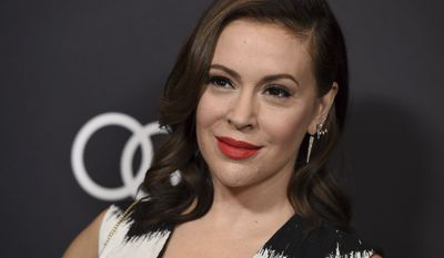 Alyssa Milano arrives at Variety's Power of Women event on Friday, Oct. 12, 2018, at the Beverly Wilshire hotel in Beverly Hills, Calif. (Photo by Jordan Strauss/Invision/AP)