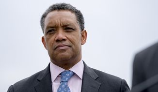 In this Feb. 26, 2018 photo, District of Columbia Attorney General Karl Racine, attends a news conference near the White House in Washington.  A spokesman for President Donald Trump's inaugural committee has confirmed on Wednesday, Feb. 27, 2019, that Racine's office has subpoenaed financial records from the committee regarding the $107 million the committee raised to hold inaugural events. (AP Photo/Andrew Harnik, File)