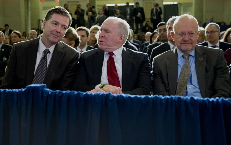 From left, FBI Director James Comey, CIA Director John Brennan, and Director of National Intelligence James Clapper sit together in the front row before President Barack Obama spoke about National Security Agency (NSA) surveillance in this Friday, Jan. 17, 2014, file photo at the Justice Department in Washington. (AP Photo/Carolyn Kaster) ** FILE **