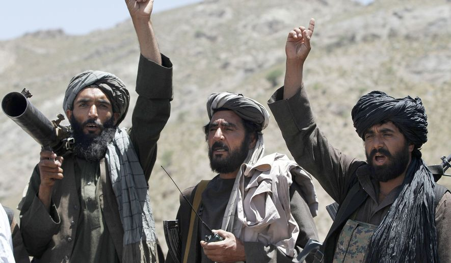 FILE - In this May 27, 2016 file photo, Taliban fighters react to a speech by their senior leader in the Shindand district of Herat province, Afghanistan. In a Thursday, March 28, 2019 report the Special Inspector General for Afghan Reconstruction, a U.S. watchdog, said that Afghanistan will remain dependent on international donors and foreign help even after a peace deal with the Taliban is reached. The report identified main high-risk areas including the reintegration of as many as 60,000 heavily armed Taliban fighters and their families back into Afghan society. (AP Photos/Allauddin Khan, File) **FILE**