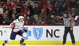 Washington Capitals' Nic Dowd (26) celebrates the game winning goal against the Carolina Hurricanes during the third period of an NHL hockey game in Raleigh, N.C., Thursday, March 28, 2019. Washington won 3-2. (AP Photo/Gerry Broome)