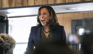 In this March 8, 2019, file photo, Sen. Kamala Harris, D-Calif., meets with supporters at Big Mike's Soul Food, in Myrtle Beach, S.C. Harris is rolling out a slate of endorsements in the critical early primary state of South Carolina. (Jason Lee/The Sun News via AP)