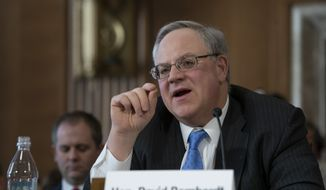 David Bernhardt, a former oil and gas lobbyist, speaks before the Senate Energy and Natural Resources Committee at his confirmation hearing to head the Interior Department, on Capitol Hill in Washington, Thursday, March 28, 2019. (AP Photo/J. Scott Applewhite)