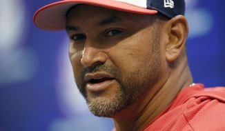Washington Nationals manager Dave Martinez speaks to the media before an opening-day baseball game against the New York Mets, Thursday, March 28, 2019, in Washington. (AP Photo/Nick Wass)