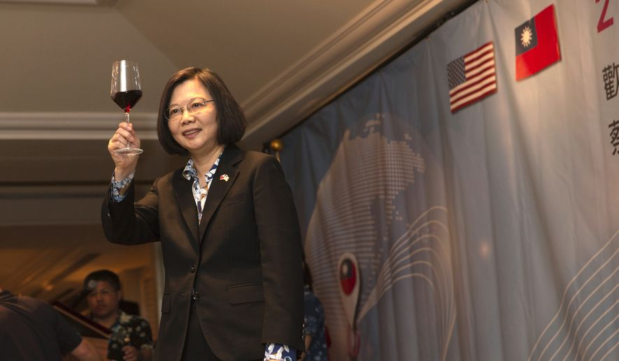 In this Wednesday, March 27, 2019 photo released by the Taiwan Presidential Office, Taiwanese President Tsai Ing-wen toasts during a banquet in Honolulu, Hawaii. Speaking during the visit to Hawaii on Wednesday, Tsai said requests have been submitted to the U.S. for F-16V fighters and M1 Abrams tanks. If approved, the move could set off new tensions between the U.S. and China, which considers Taiwan its own territory to be annexed by force if necessary. (Taiwan Presidential Office via AP) **FILE**